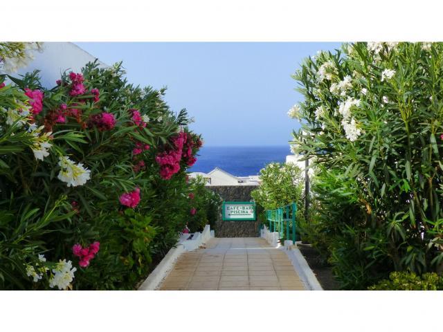 Hallway to the bar and restaurant  - Nice Seaview Apartment, Puerto del Carmen, Lanzarote