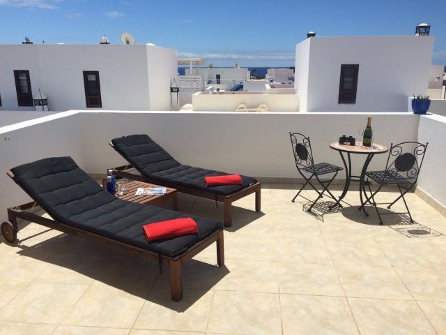 Spacious 2 bedroom duplex in Puerto Calero, with communal pool, WiFi, English TV, 3 sunny terraces, quiet location.