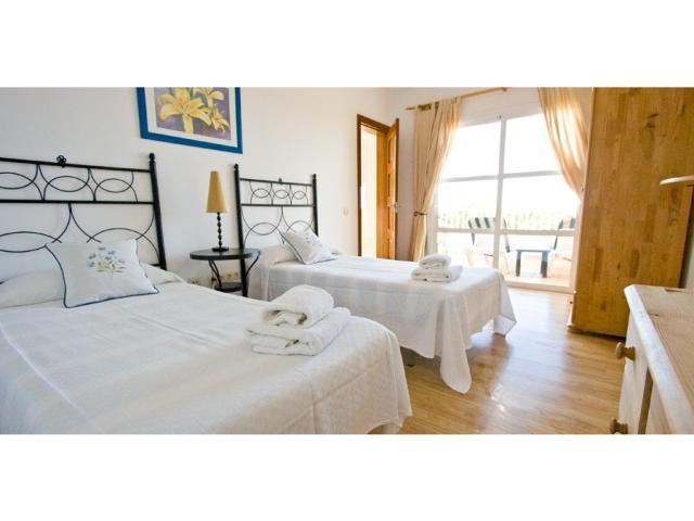 twin bedroom with patio doors - Villa Clara, Costa Teguise, Lanzarote