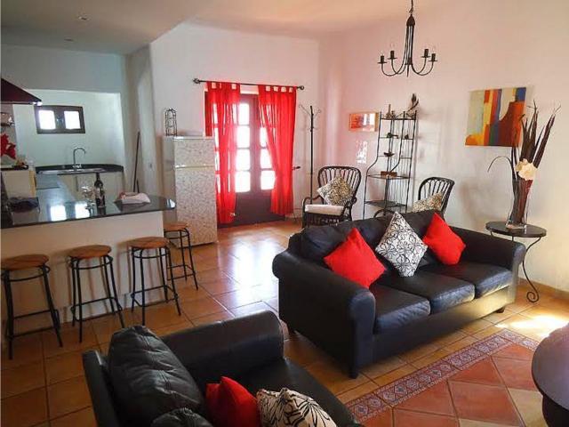 Kitchen leading into lounge - 3 bedroom villa apartment, Punta Mujeres, Lanzarote