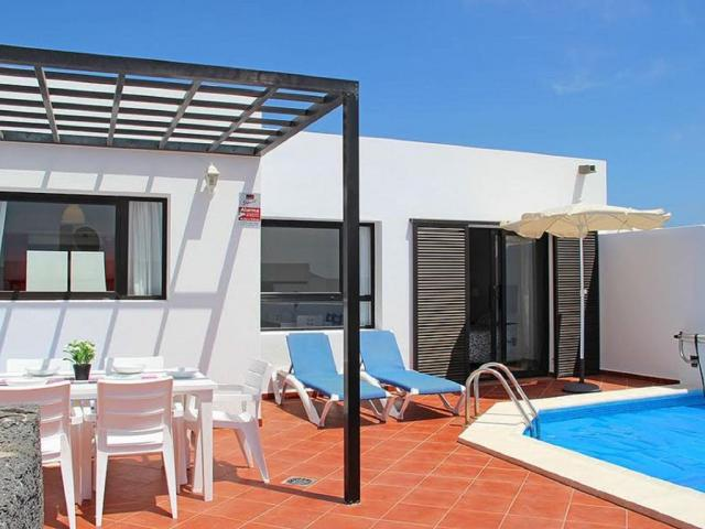 Beautiful 4 bedroom 2 bathroom Villa in Playa Blanca Lanzarote. Heated Pool Free WI-FI Parking Sleeping up to 8 persons